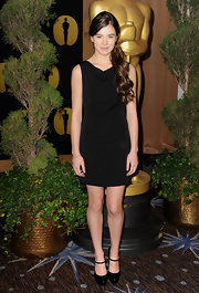 Hailee Steinfeld kept her black shift dress youthful with black patent maryjane platforms.