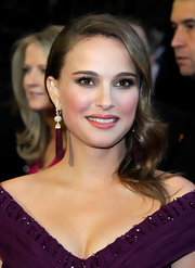 Natalie Portman softened her look with side swept curls at the 2011 Academy Awards. Her lilac make-up hues perfectly matched her stunning off-the-shoulder custom Rodarte gown. Exquisite!