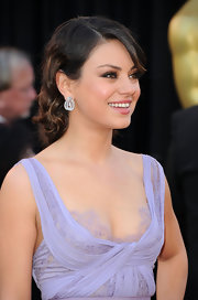 Mila paired her soft lilac dress with diamond double drop earrings.