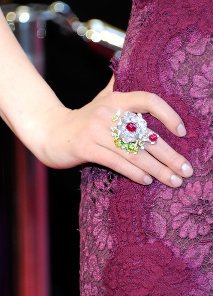 Scarlett Johansson paired her lace-clad dress with a multi-hued flower cocktail ring.