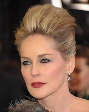 Actress Sharon Stone channeled the 'Black Swan' with deep maroon lips and a smoky eye at the 2011 Oscar Awards.