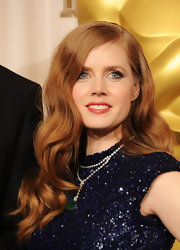 Amy Adams looked ultra glamorous at the 83rd Annual Academy Awards. She paired her sequined L'Wren Scott dress with cascading waves.