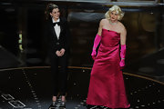 In a surprise twist, Anne appeared on the Oscars stage in a sleek tuxedo, complete with a floppy bow tie and shimmering heels, while cohost James Franco gave a gown a try.