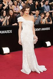 Milla was a vision in white, wearing a beaded one-shoulder dress that perfectly showed off her model curves.