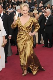 Meryl Streep shined in a gold gown complete with draped detailing and matching kicks.