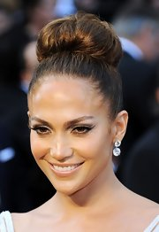 Jennifer Lopez Attended the 84th Annual Academy Awards wearing her hair in a chic voluminous bun.