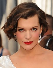 Milla Jovovich wore her hair in bouncy waves at the 84th Annual Academy Awards.