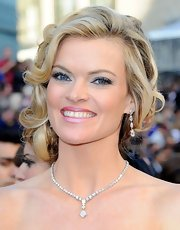 Missi Pyle wore her hair in an updo featuring soft curls at the 84th Annual Academy Awards.