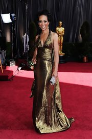 Shaun Robinson shined on the red carpet in a bronze halter gown complete with a draped bodice.
