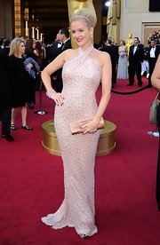 Penelope Ann Miller attended the 84th Annual Academy Awards wearing a one-of-a-kind 24-carat diamond encrusted art deco cuff bracelet.