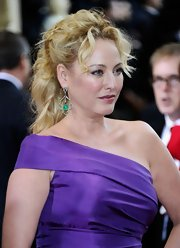 Virgina Madsen arrived at the 84th Annual Academy Awards wearing her hair a curly ponytail.