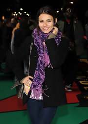 A bright purple scarf gave an extra dose of energy to Victoria's fall look.