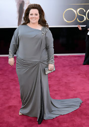 Melissa McCarthy channeled modern elegance at the 2013 Oscars in a custom silk jersey long-sleeved gown with an asymmetrical neckline featuring beaded accents.