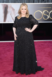 Adele not only stunned the crowd with her big voice, but the singer wowed at the Oscars in this fully beaded black tulle gown.