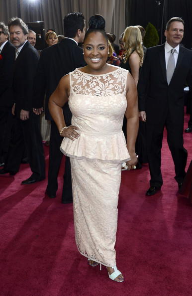 Sherri Shepherd flaunted her girlie side at the 2013 Oscars with a blush embroidered, lace peplum gown.