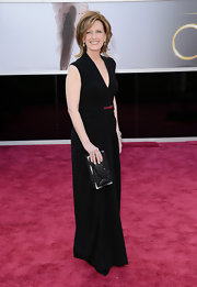 Anne Sweeney opted for a classic black dress with a plunging neckline and draping for her red carpet look at the 2013 Oscars.