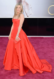Jennifer Aniston is known for her classic style like this red strapless gown with a full skirt, which she wore to the 2013 Oscars.