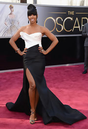 Kelly Rowland opted for a black and white strapless gown with a front slit and flowing train for her red carpet look at the 2013 Oscars.
