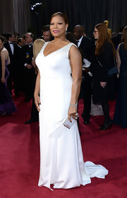 Queen Latifah chose a simple and elegant white gown with beaded straps for her red carpet look at the 2013 Oscars.