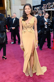 Naomie Harris showed off her edgier side with this gold gown with an embellished bodice and front slit.