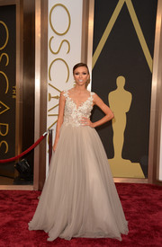 For the 2014 Academy Awards, Giuliana Rancic chose a nude couture gown by Australian designer Paolo Sebastian that boasted a floral beaded bodice and tulle skirt.