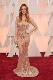 Catt Sadler looked absolutely radiant at the Oscars in a gorgeous Charbel Zoe sheer-illusion gown rendered in geometric-patterned sequins.