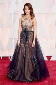 Jamie Chung made an appearance at the Oscars wearing a nude and black Yanina Couture gown with beading that looked like bursts of fireworks.