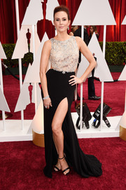 For her Oscars red carpet look, Keltie Knight slipped into an alluring Mac Duggal gown with a beaded bodice and a thigh-high slit.