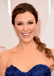 Thea Andrews kept it fun and youthful with this segmented ponytail when she attended the Oscars.