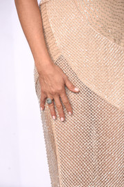 Jennifer Aniston matched her nude gown with neutral nail polish..