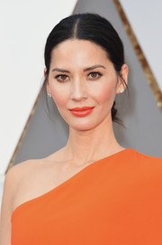 Olivia Munn was in the mood for brights with this orange lippy and gown combo.