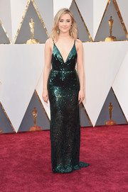 Saoirse Ronan took a daring plunge in a shimmery emerald Calvin Klein gown for her Oscars red carpet look.