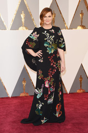 Amy Poehler looked charming on the Oscars red carpet in an Andrew Gn cape-detail gown with butterfly and flower sequins.