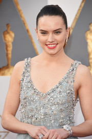 Daisy Ridley teamed her beaded dress with a Chanel diamond bracelet and a matching ring for total glamour at the Oscars.