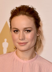 Brie Larson swept her tresses back into a messy ponytail for the Academy Awards nominee luncheon.