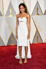 Naomie Harris went for bold glamour at the 2017 Oscars in a strapless white Calvin Klein frock with a slashed midriff and a long train.