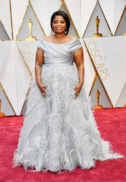 Octavia Spencer made a breathtaking choice with this feather-embellished off-the-shoulder gown by Marchesa for her 2017 Oscars look.