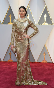 Jessica Biel looked quite the glamazon in a distressed gold sequin gown by Kaufmanfranco at the 2017 Oscars.