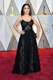 Salma Hayek was equal parts sweet and sexy in a black spaghetti-strap lace gown by Alexander McQueen at the 2017 Oscars.