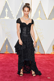 A pair of two-tone lace-up heels finished off Alicia Vikander's look.