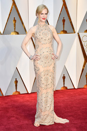 Nicole Kidman chose an ornately embellished nude halter gown by Armani Privé for her 2017 Oscars look.