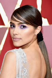 Olivia Culpo contrasted her striking eye makeup with a pale lip.