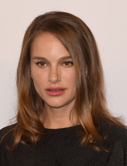 Natalie Portman styled her hair with a side part and bouncy, curly ends for the Academy Awards nominees luncheon.