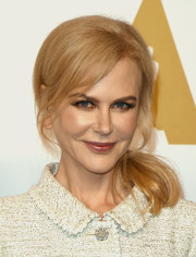 Nicole Kidman went retro with this teased, loose ponytail at the Academy Awards nominees luncheon.