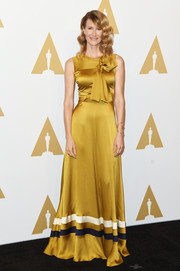 Laura Dern shone in a bowed and striped marigold gown by Roksanda at the Academy Awards nominees luncheon.