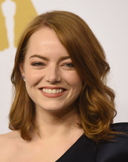 Emma Stone sported shoulder-length curls when she attended the Academy Awards nominees luncheon.