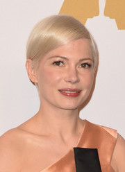 Michelle Williams wore her short hair slicked down with a side part at the Academy Awards nominees luncheon.