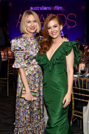 Naomi Watts paired a multicolored box clutch with a floral gown for the Australians in Film Awards Gala.