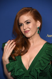 Isla Fisher matched her green gown with a pair of emerald drop earrings by Anabela Chan for the Australians in Film Awards Gala.