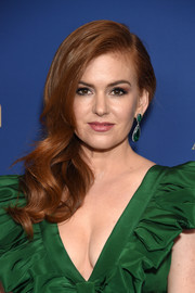 Isla Fisher looked glamorous with her side-swept curls at the Australians in Film Awards Gala.